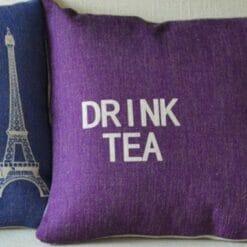 Purple cushion with drink tea slogan