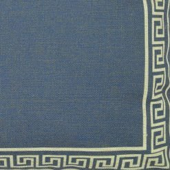 Close up of deep blue cushion cover with pattern