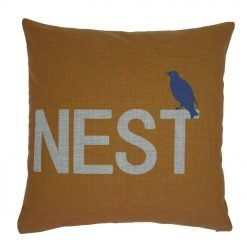 Orange linen cushion with text saying Nest and and bird