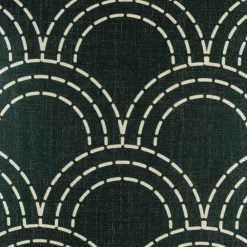 Dark coloured cushion covers with thin light interlocking semi-circles