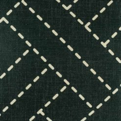 Close up of dark cushion cover with woven design
