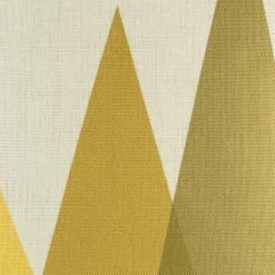 Close up of overlapping yellow shapes on cushion cover