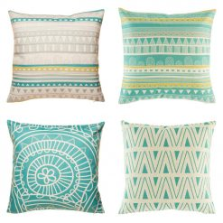 Collection of four cushion covers with teal and yellow accents