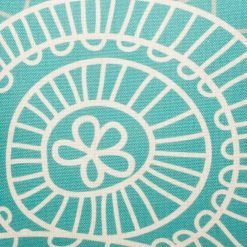 Close up of teal cushion cover with white pattern