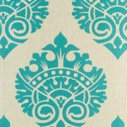 Close view of regal design in teal on linen cushion