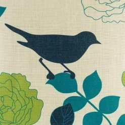 Close view of bird image on cushion cover in dark blue