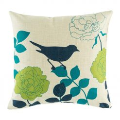 Dark image of bird on cushion with teal green and dark blue