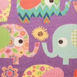 Close up view of purple cushion with colourful elephants