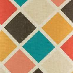 Close up of diamond pattern in teal dark brown yellow and pink on cushion cover