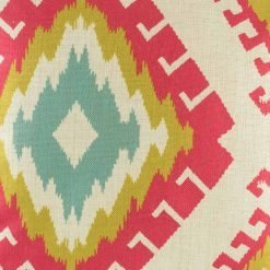 Close up of pink, green and blue cushion cover