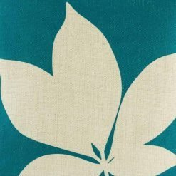 Close up of teal cushion cover with leaf