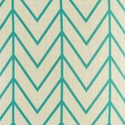 Close up of teal arrows on cushion cover
