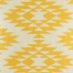 Close up of decorative cushion with yellow print