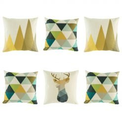 Beautiful 6 cushion collection with 2 brown triangle trees, 3 teal, green and blue geometric diamonds and 1 bold stag head cushion cover