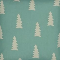 Close up of teal cotton linen cushion cover with pine tree design