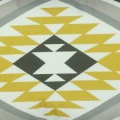 Close up of aztec inspired velvet cushion cover