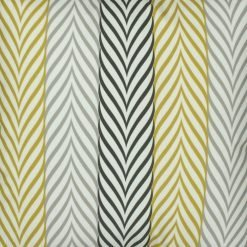 Close up of striped monochromatic yellow velvet cushion