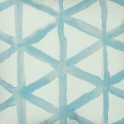 Close up of modern light blue and white velvet cushion cover