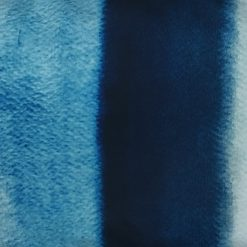 Close up of monochromatic blue velvet cushion cover