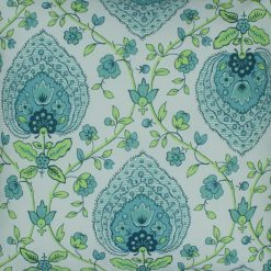Close up of green and tiffany blue floral design cushion
