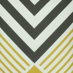Close up of velvet cushion with yellow and black illusion pattern