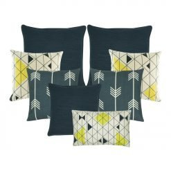 A collection of 8 blue and white cushion covers with arrow and diamond patterns