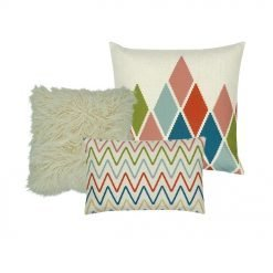 A collection of 3 cushion covers with diamond and zigzag patterns