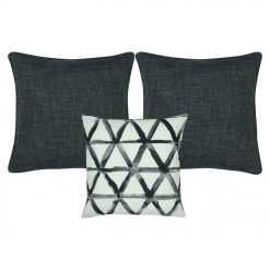 A collection of dark grey and white cushion covers with diamond triangle patterns