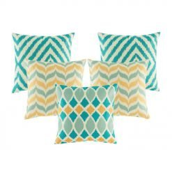 A collection of 5 cushions with teal and gold colours in chevron pattern