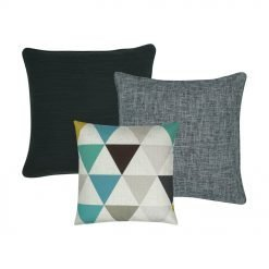 A set of three cushion covers in teal and grey colours and triangle patterns