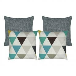 A set of four square cushions in teal and grey colours and triangle patterns