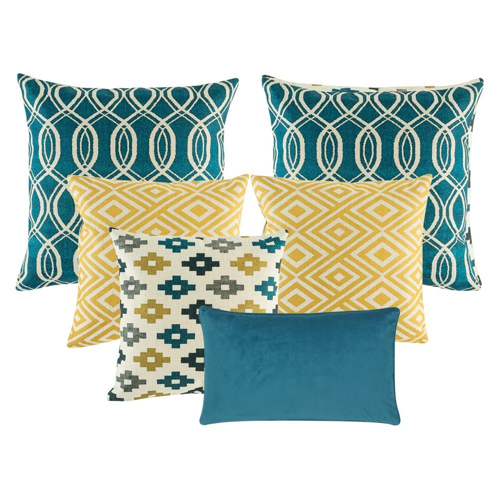 A collection of 6 square and rectangular cushion covers in blue and gold colours and with diamond and spiral patterns