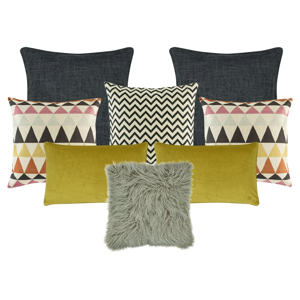 two plain grey cushion cover a pair of pink,grey and orange patterned cushion cover, a black and white cushion cover in black and white, a grey fur cushion cover, and two rectangular cushion cover in mustard