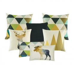A set of seven cushion covers in gold, green and blue colours with triangle and moose prints
