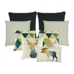 A collection of eight cushion covers in black, white and green colours with triangle and moose design