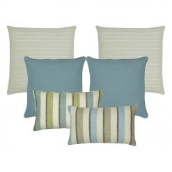 A collection of blue and white cushion covers in solid and line patterns