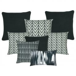 Three pieces of plain black cushion cover, 3 black and white cushion cover with chevron patterns, 1 black and white cusion cover, and one rectangular cushion in black and white