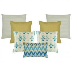 A set of 7 cushions covers with solid, modern floral, cable knit and chevron patterns and in gold and blue colours
