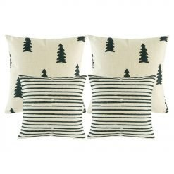 A photo of four white and grey cushions in pine and stripes design