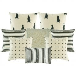 Photo of eight cushion covers with stripes, cross, tree patterns in grey and white colours