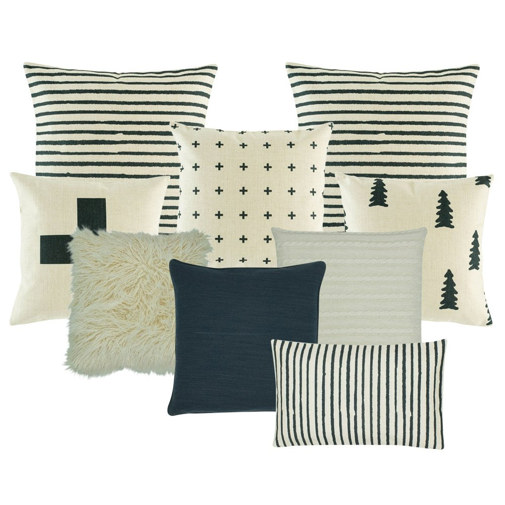 2 cushion with black and white stripes, 1 black and white with small cross design one plain white fur, one pine tree printed cushion, one plain white cushion, one plain dark grey cushion, one black and white with big cross cushion, and one rectangular cushion