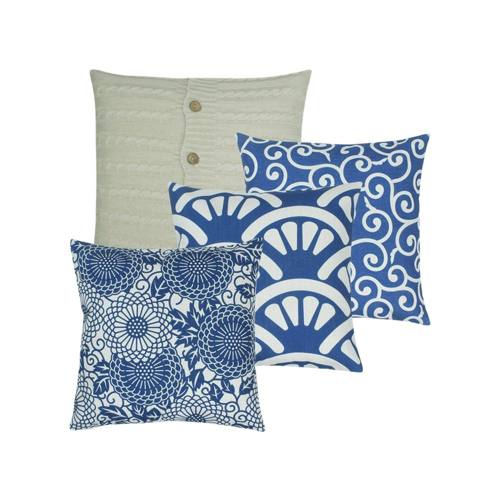 A collection of 4 square blue and white cushions in shell, floral, wind and cable knit patterns
