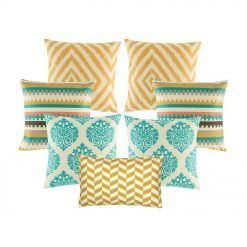 A set of 7 cushion covers with diamond and, zigzag and crown patterns in gold and teal colours