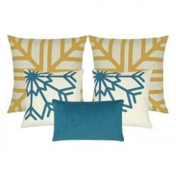 A set of five square and rectangular cushions in gold and blue colours with snowflakes design