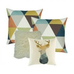 A collection of four cushion covers in teal, gold and white colours in triangle and moose design