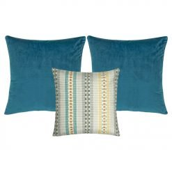 A patterned cushion and two plain blue cushion