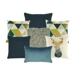 A collection of seven cushion covers in blue, grey and canvas colours with triangle and moose designs