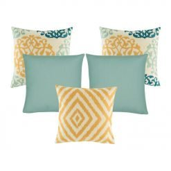 A collection of 5 square cushion covers with floral, chevron and solid patterns with duck egg and orange colours