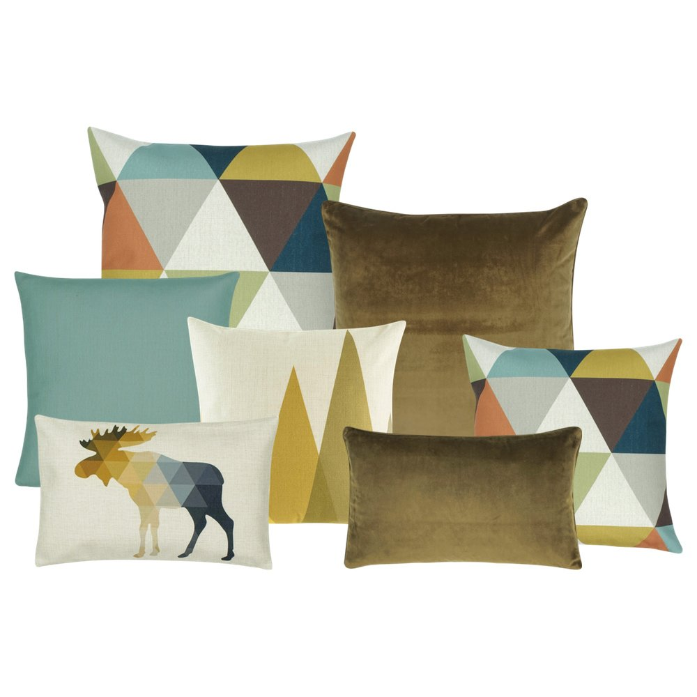 A pair of cushion in brown, yellow, and blue triangle patterns, a white and yellow cushion a blue cushion, a rectangular cushion with moose design, a brown rectangular cushion and one square brown cushion