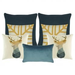 A collection of seven cushion covers in gold, white and blue colours